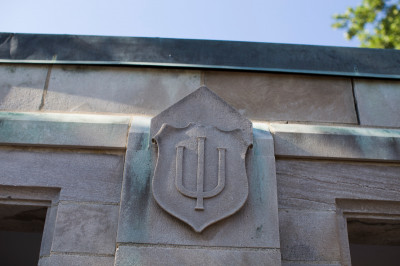 A limestone trident on an IU building