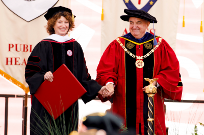 Laurie Burns McRobbie and Michael A. McRobbie wearing commencement robes