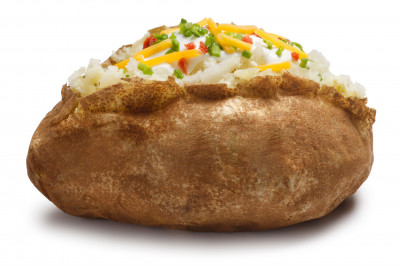 A baked potato with several toppings