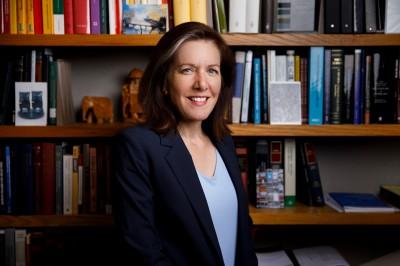 Hannah Buxbaum in front of a bookshelf