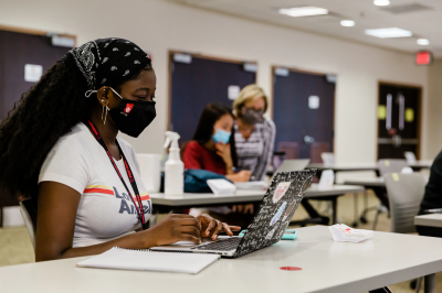 Students wearing face masks attend a lecture