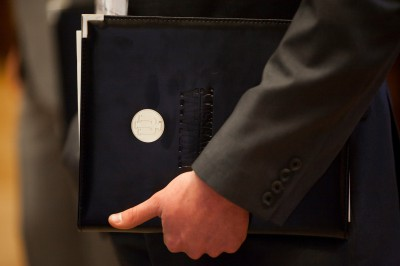 A hand holding a portfolio with an IU logo