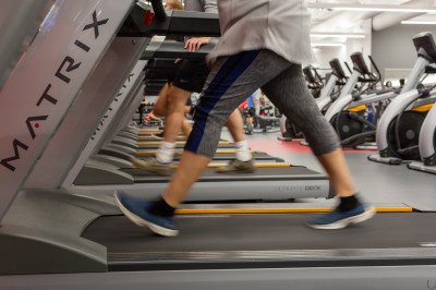 Feet move on treadmills at the Campus Recreation Center in the IUPUI Campus Center.