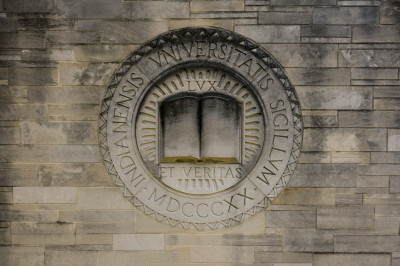 A limestone seal of Indiana University.