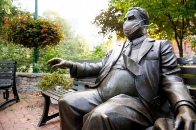 Herman Wells statue in an IU-branded mask