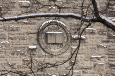 IU seal on a limestone building