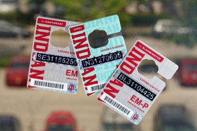 Several 2018-19 employee parking permits are displayed.