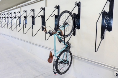 bike on rack mounted vertically on an indoor wall