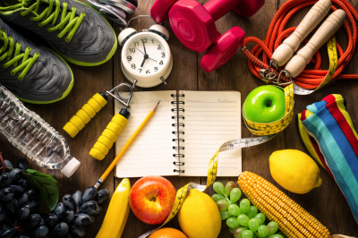 a collection of healthy food and exercise equipment on a table