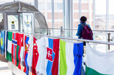 A row of flags hanging in the Campus Center