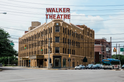 a view of the multi-story Walker Theater from the street
