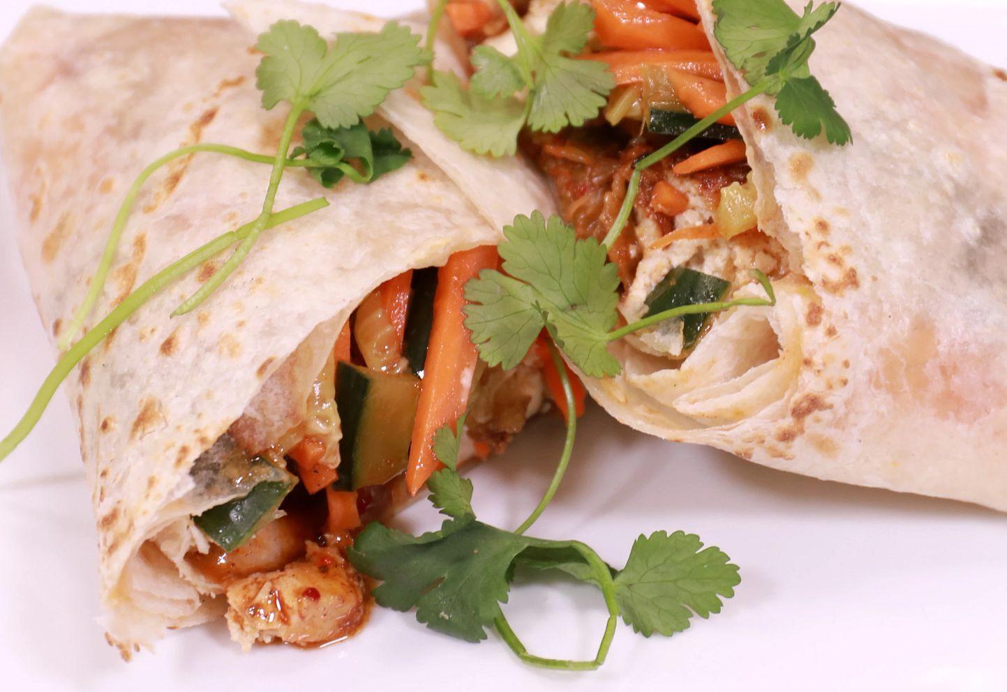 a burrito on a plate