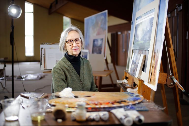 "Bonnie Sklarski, creator of the ""Lux et Veritas"" paintings for the IU Bicentennial."