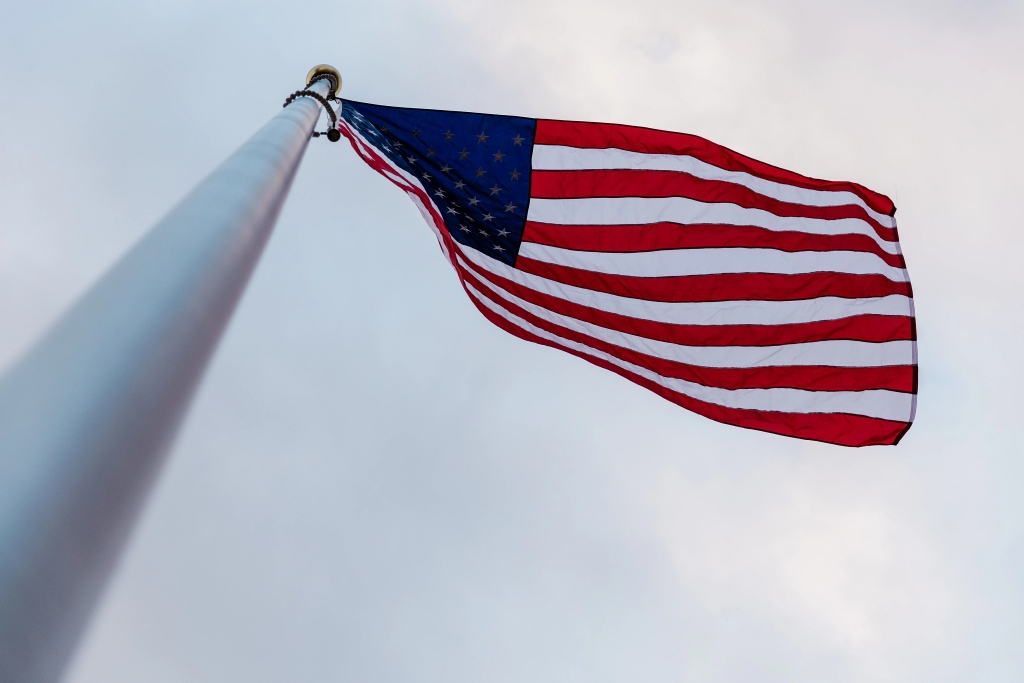 A view of the American flag from the bottom of the pole