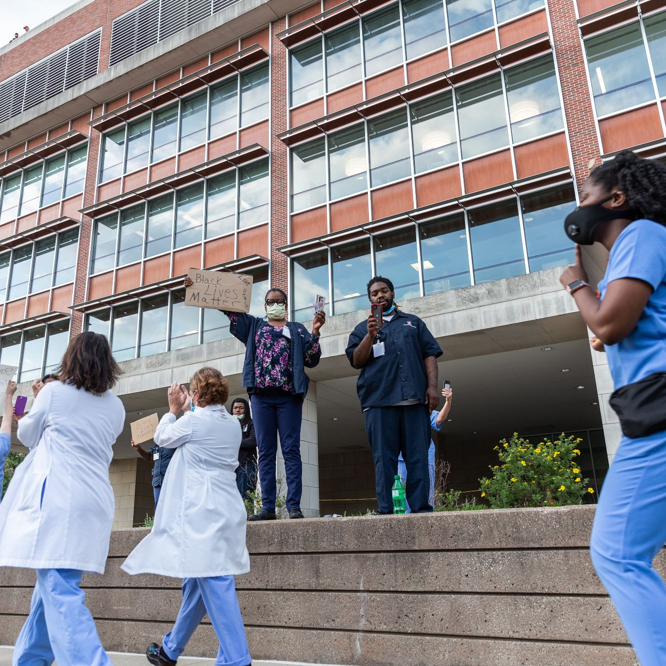Hospital workers cheer on marchers