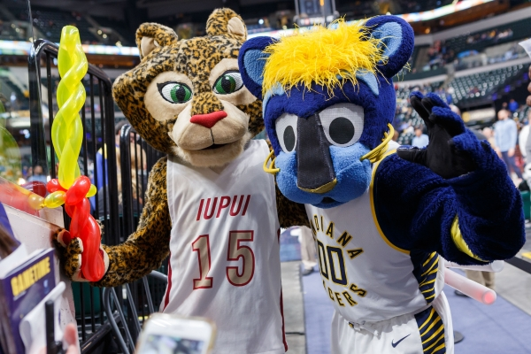 Jazzy, the IUPUI mascot, poses with Boomer, the Indiana Pacers mascot, at a Pacers game.