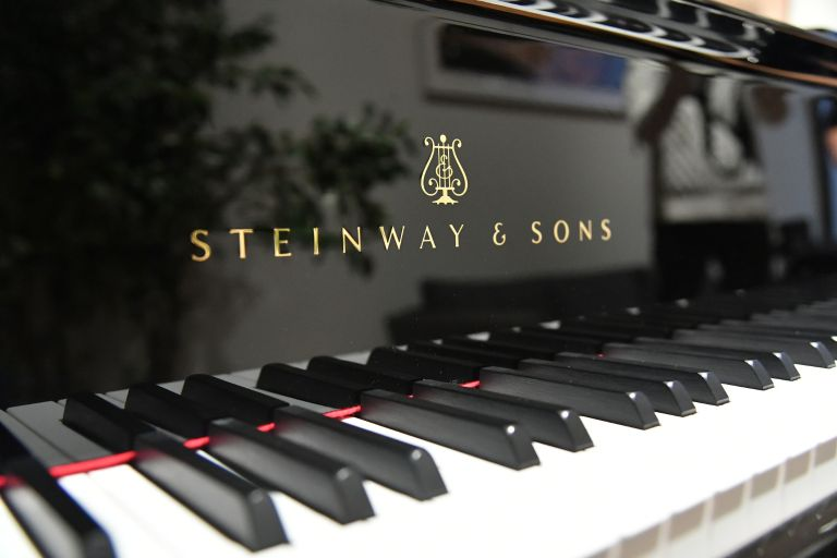 Closeup of the keyboard of a Steinway piano.