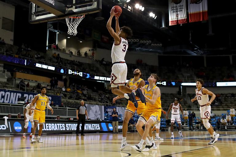 an illnois player dunks the basketball