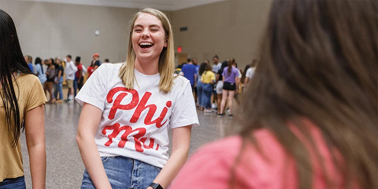 An IUPUI student and member of Phi Mu sorority enjoys PLAYFAIR during WOW.
