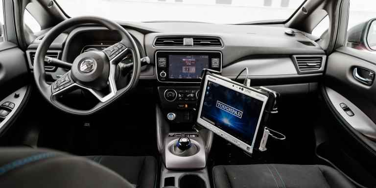the interior of the vehicles with a screen inside