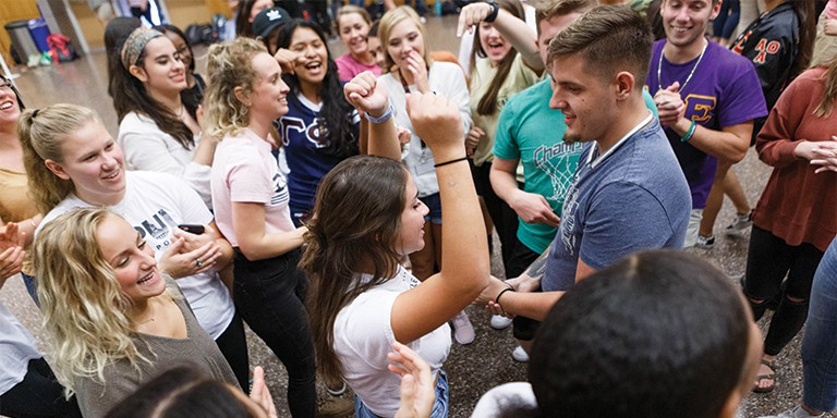 IUPUI students enjoy campus' largest ice breaker, PLAYFAIR, with a round of rock-paper-scissors.