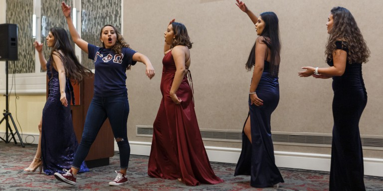 Gamma Phi Omega International Sorority Inc. performs their stroll at the installation.