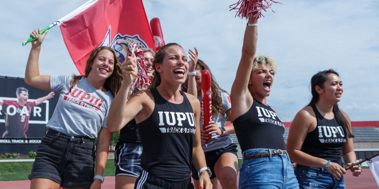 IUPUI students cheer on the Jaguars at the men's soccer match.