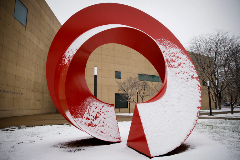 A red statue on the IU Bloomington campus covered in snow.