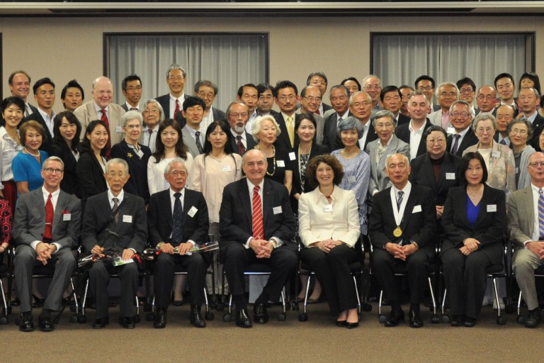 IU President McRobbie and First Lady Laurie Burns McRobbie sit with Japanese alumni