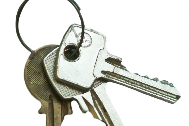 Keyring of house keys on white background