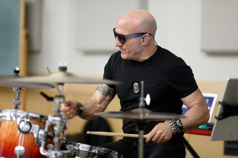Kenny Aronoff plays drums during a recent visit to the IU Bloomington campus.