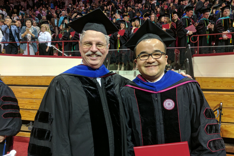 Craig Holden with IU student Lu Dong