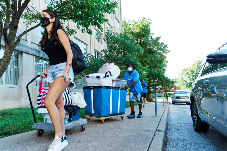 Students their belongings on carts during move-in at IU Bloomington