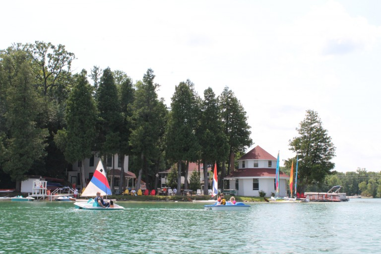 Children in boats on the lake at Camp Brosius