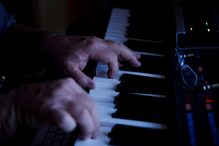 A closeup of two hands playing a keyboard
