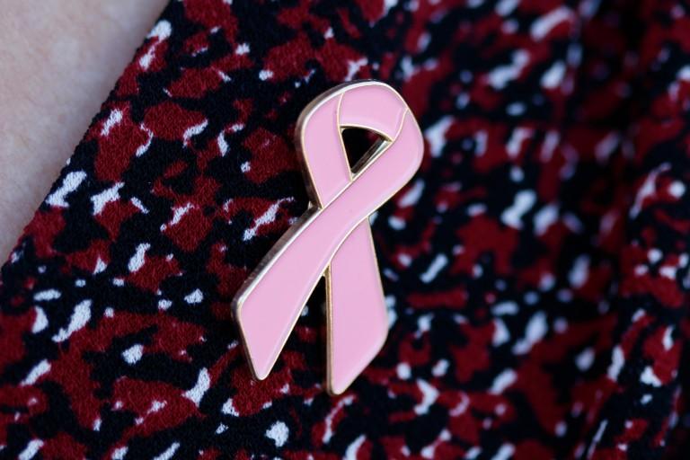A pink ribbon pin.