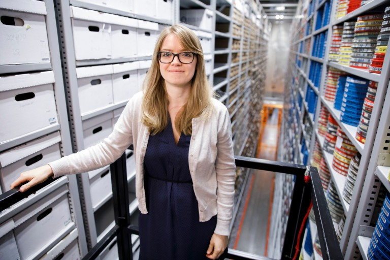 Carla Arton on a lift in the Auxiliary Library Facility