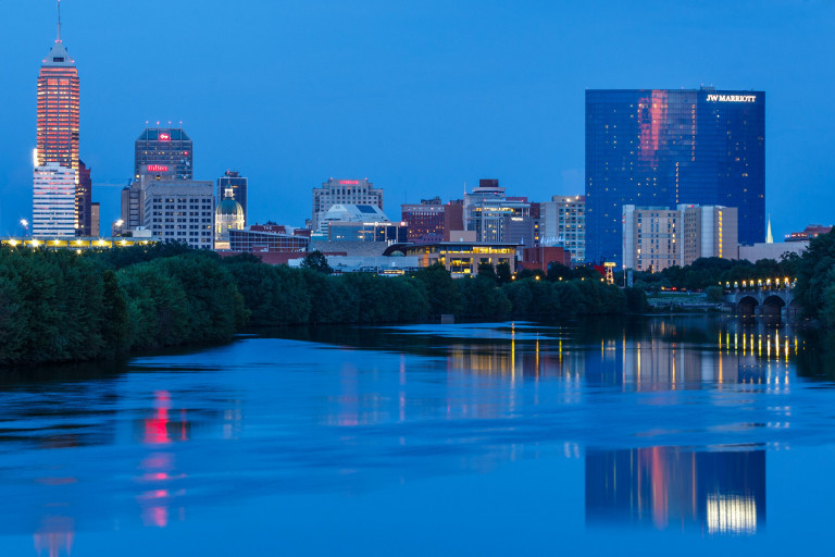 Indianapolis skyline at dusk along White River Parkway