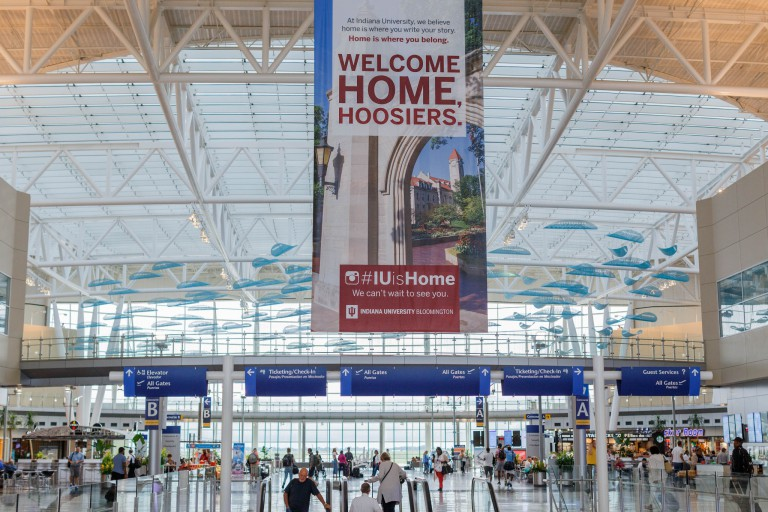 A 'Welcome home, Hoosiers' banner hanging in the airport
