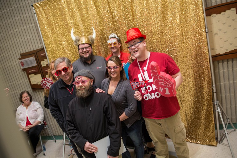 IU Kokomo students pose for a picture in a photo booth with props