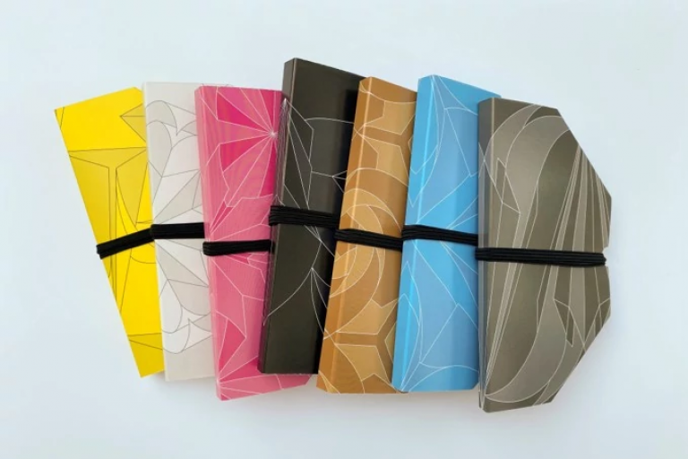 A row of origami face masks in a variety of colors