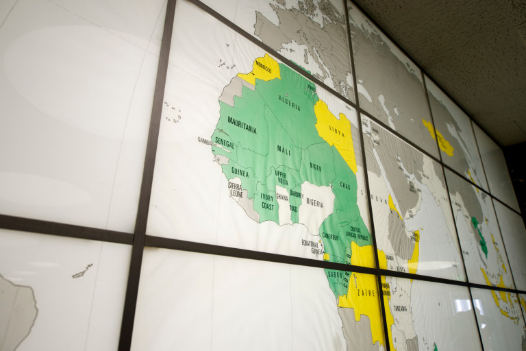 A map of the world on a large screen in Ballantine Hall