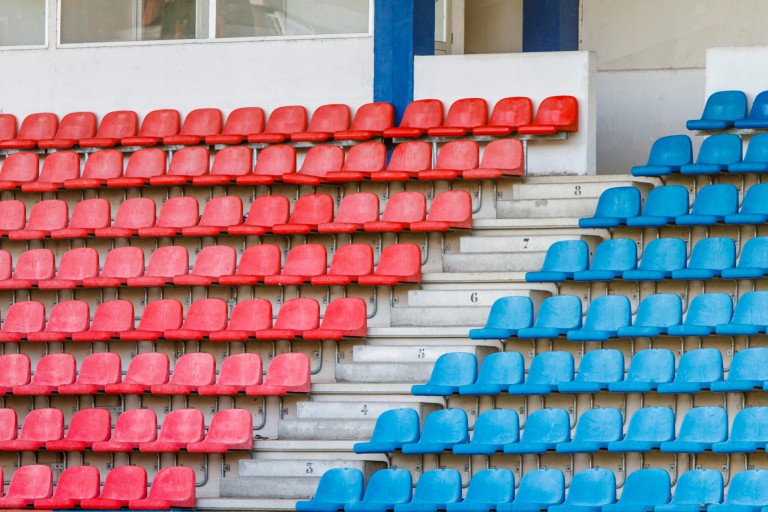Red and blue bleacher chairs