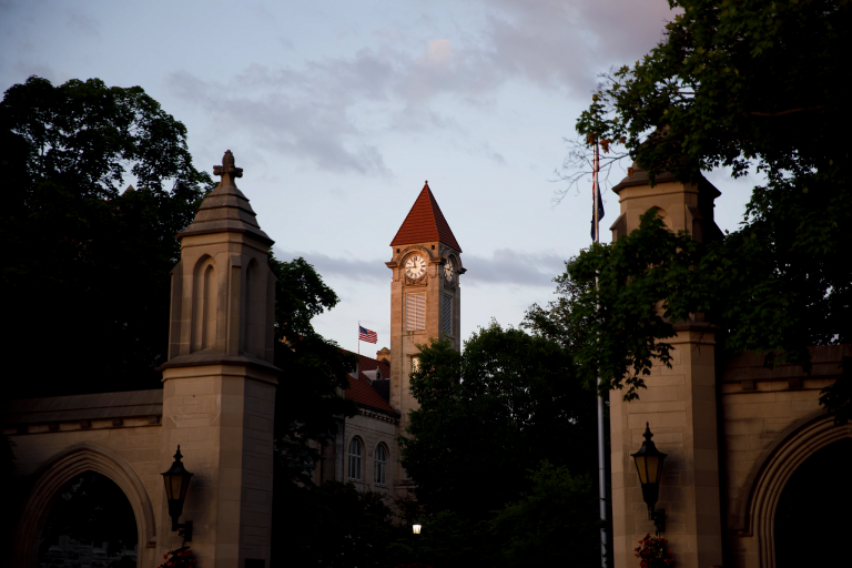 The Student Building clock tower is pictured through the Sample Gates at IU Bloomington.