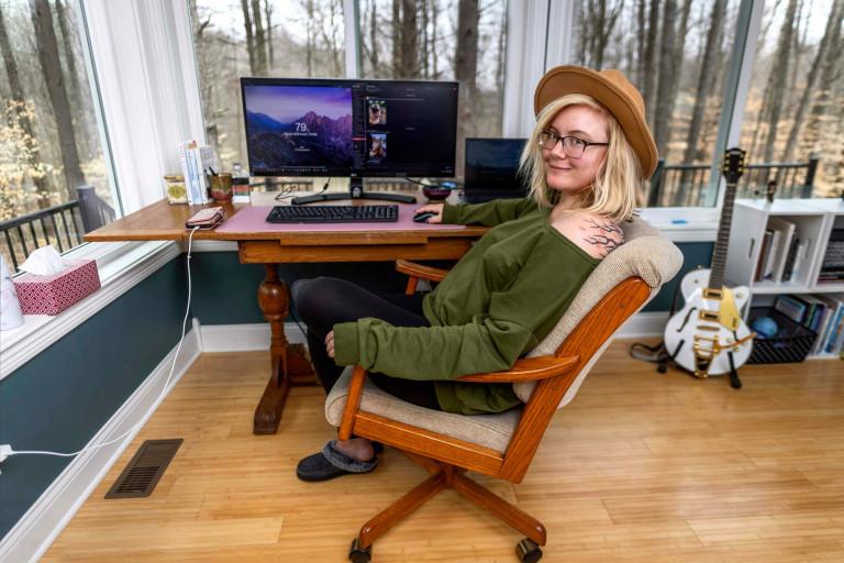 Woman sits at computer desk