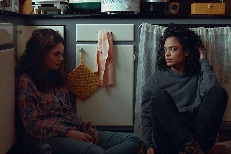 Two women sit on the kitchen floor in a scene from 'Little Woods'