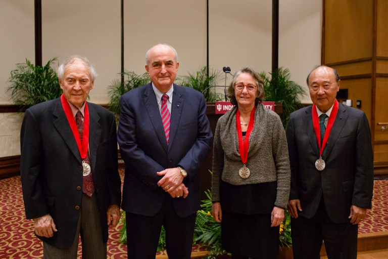 IU President McRobbie stands with the award recipients