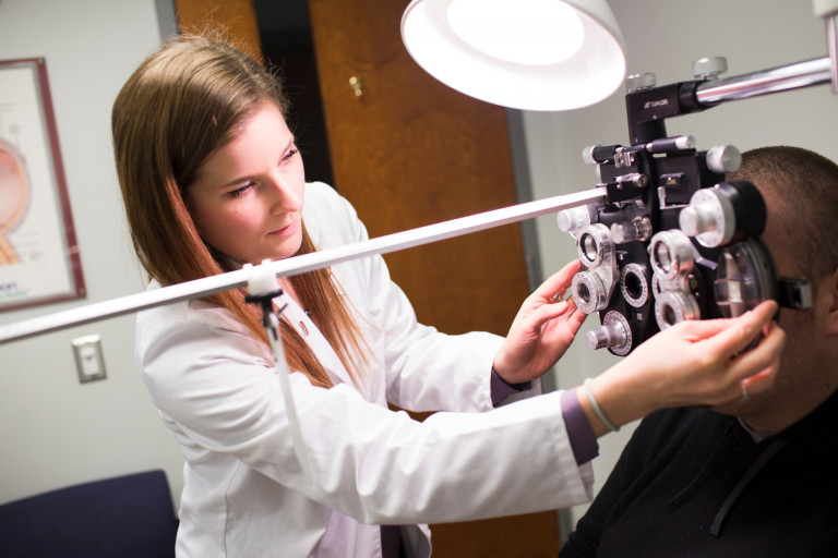 An optometrist examines a patient's eyes