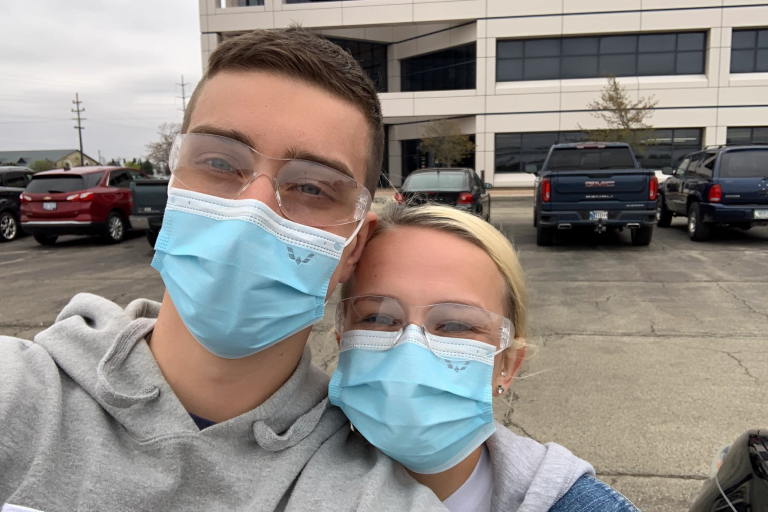 Alex Combs and Kate Wampler in face masks at GM