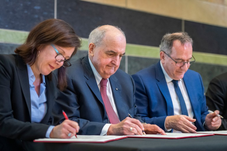 Hannah Buxbaum, Michael A. McRobbie and Jean Chambaz sign partnership agreements at IU